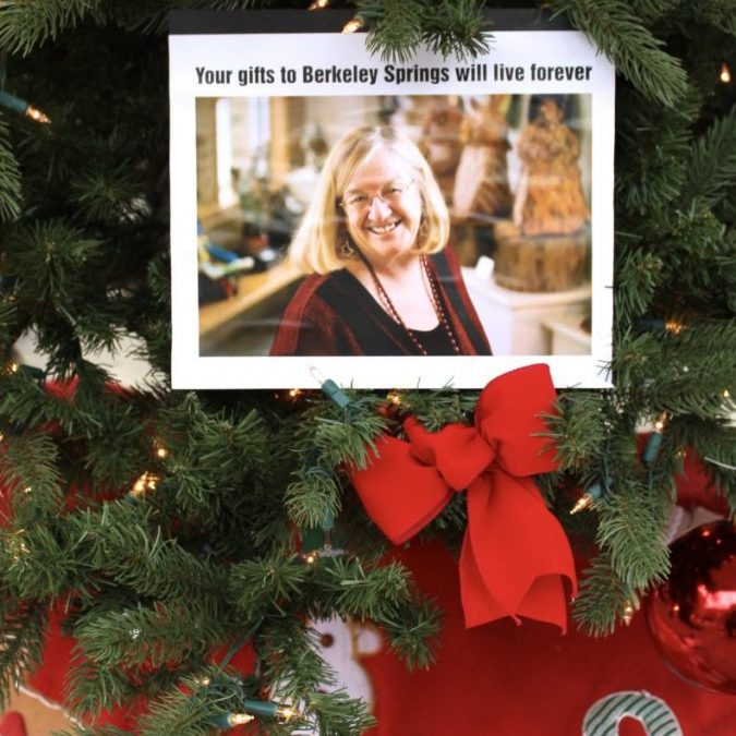 "A photo tribute to Jeanne Mozier hangs on the Memorial Tree set up in the Berkeley Springs State Park gazebo. Mozier spent every Apple Butter Festival weekend in the gazebo as the ""voice"" of the event for decades."