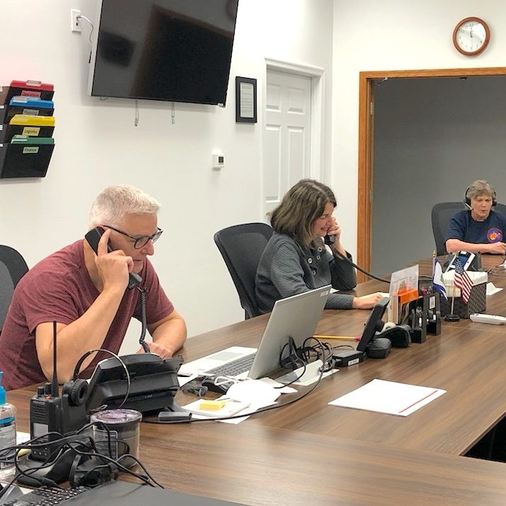 Volunteers Lori Kiley, Rob and Debra Gaydos make phone calls to schedule Morgan County residents for local vaccine clinics. Not pictured but present is volunteer Jim Hoyt.